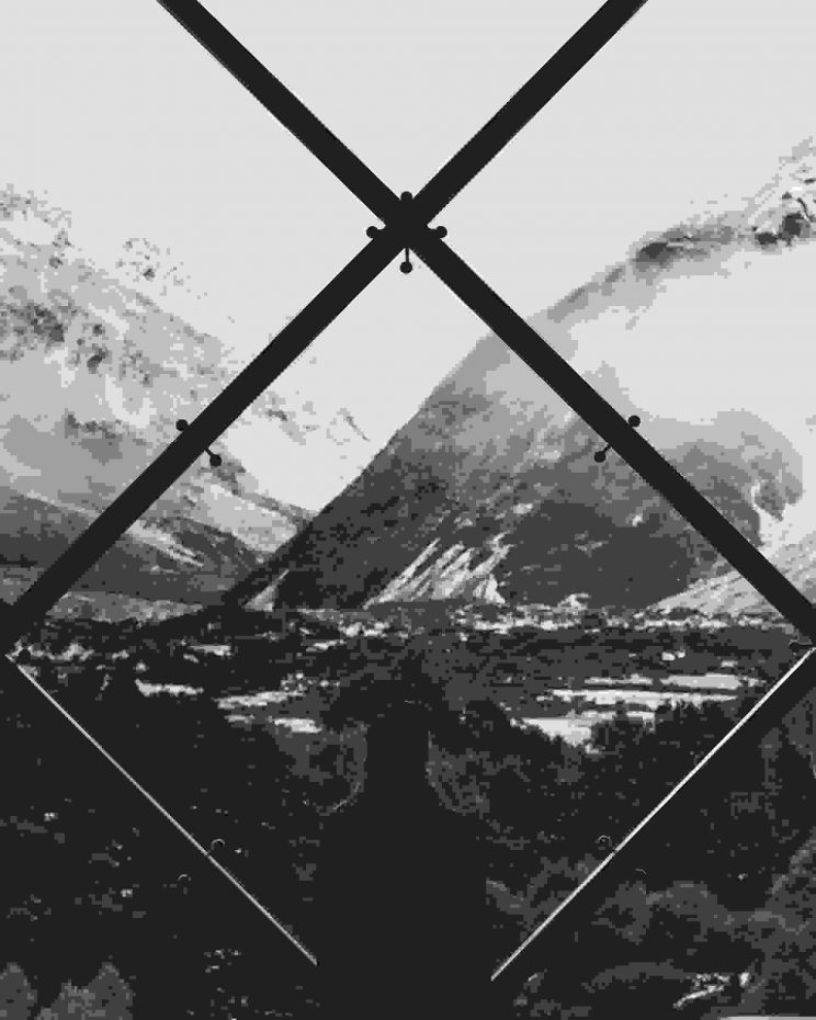 Overlooking mountains through huge glass window